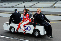 "4-25 May 2008, Indianapolis, Indiana, USA. Milka Duno gets ride back to her garage after rain ends practice on ""Fast Friday""..©2008 F.Peirce Williams USA."