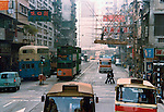 Transport in Hong Kongs busy streets and bamboo scaffholding .Pictures taken in Hong Kong China in 1977 at the time of the cultural revolution.