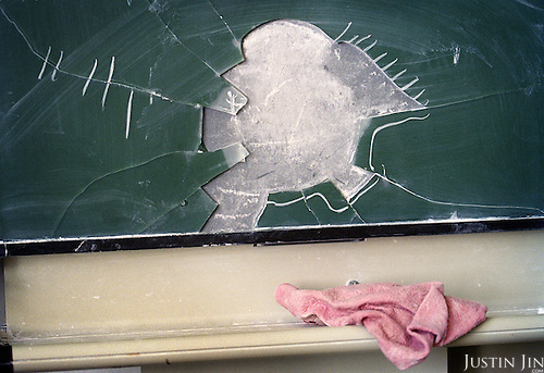 A smashed up blackboard at a vocational secondary school in east Amsterdam..The school is mostly made up of kids of Turkish and Moroccan backgrounds.  .Picture shot in Amsterdam in 2004 by Justin Jin. .