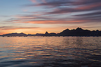 Evening light over mountains and icy water near Tasiilaq, east Greenland