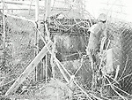 A picture of an very old dog house of ran down over the years.