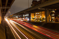 Cinematic nighttime view of Austin's upper and lower deck of I-35 transportation corridor in downtown Austin, Texas.