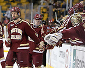 Michael Matheson (BC - 5), Teddy Doherty (BC - 4), Brad Barone (BC - 29) - The Boston College Eagles defeated the Harvard University Crimson 4-1 in the opening round of the 2013 Beanpot tournament on Monday, February 4, 2013, at TD Garden in Boston, Massachusetts.