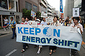 August 6, 2011 - Tokyo, Japan - Protestors hold anti-nuclear signs as they take on the streets in the Shibuya district part of Tokyo: August 6 marks the 66th anniversary of the US atomic bombing of Hiroshima in 1945 as Japan still continues to struggle to end the nuclear crisis since the March 11 earthquake and tsunami. (Photo by Yumeto Yamazaki/AFLO)