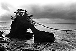 A huge rock, Hatagoiwa, on the seashore of Noto Peninsula. The rock is tied with another rock by a sacred rope..