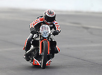 Mar 13, 2015; Gainesville, FL, USA; NHRA pro stock motorcycle rider Eddie Krawiec during qualifying for the Gatornationals at Auto Plus Raceway at Gainesville. Mandatory Credit: Mark J. Rebilas-