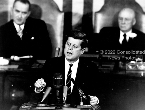 "United States President John F. Kennedy outlined his vision for manned exploration of space to a Joint Session of the United States Congress, in Washington, DC on May 25, 1961 when he declared, ""...I believe this nation should commit itself to achieving the goal, before this decade is out, of landing a man on the Moon and returning him safely to the Earth."" This goal was achieved when astronaut Neil A. Armstrong became the first human to set foot upon the Moon at 10:56 p.m. EDT, July 20, 1969.  Shown in the background are, (left) Vice President Lyndon Johnson, and (right) Speaker of the House Sam T. Rayburn (Democrat of Texas). .Credit: NASA via CNP"