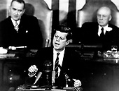 """United States President John F. Kennedy outlined his vision for manned exploration of space to a Joint Session of the United States Congress, in Washington, DC on May 25, 1961 when he declared, """"...I believe this nation should commit itself to achieving the goal, before this decade is out, of landing a man on the Moon and returning him safely to the Earth."""" This goal was achieved when astronaut Neil A. Armstrong became the first human to set foot upon the Moon at 10:56 p.m. EDT, July 20, 1969.  Shown in the background are, (left) Vice President Lyndon Johnson, and (right) Speaker of the House Sam T. Rayburn (Democrat of Texas). .Credit: NASA via CNP"""