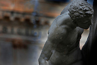 Detail of a male sculpture, Fontana Diana, Giulio Moschetti, 1906, on Piazza Archimede in Ortigia, Syracuse, Sicily, pictured on September 13, 2009, in the morning. The Diana Fountain is the centre of the Piazza Archimede in Ortigia, the historic centre of Syracuse. It tells the mythological story of Diana transforming the nymph Arethusa into a spring on a site in Ortigia. Ortigia is one of the names associated with the goddess Artemis, the Romans identified her as Diana. The Piazza is named after the greek mathematician and philosopher Archimede who died defending Syracuse against the Romans. Today the city is a UNESCO World Heritage Site. Picture by Manuel Cohen.