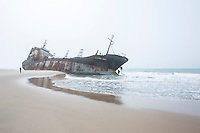 Benin - Marina - A fishing boat stranded on the shoreline in the outskirts of Cotonou, the boat was brought ashore by the strong high tide.
