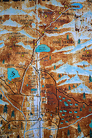 A rusting, hand painted map of the region in the town centre.