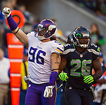Minnesota Vikings defensive end Brian Robinson (96) celebrates a defensive play against the Seattle Seahawks at CenturyLink Field in Seattle, Washington on  November 17, 2013.  The Seahawks beat the Vikings 41-20.  ©2013.  Jim Bryant. All Rights Reserved.