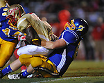 Oxford High's Joel Forrester (61) and Oxford High's Xavier Pegues (44) tackle Lafayette High's D.K. Buford (2) at Bobby Holcomb Field in Oxford, Miss. on Thursday, August 30, 2012. Oxford High won 19-0.