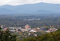 An aerial view of the downtown mall cityscape with mountains in Charlottesville, VA. Photo/Andrew Shurtleff