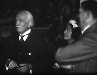 BNPS.co.uk (01202 558833)<br /> Pic: Mullocks/BNPS<br /> <br /> Lloyd George chats to Hitler at his home in the Bavarian alps.<br /> <br /> A remarkable film of David Lloyd George's visit to Germany to meet Adolf Hitler in 1936 after which he described him as 'the greatest living German' has emerged for auction.<br /> <br /> The unique black and white 16mm film which lasts 20 minutes shows former Prime Minister Lloyd George and his entourage twice meeting Hitler and driving along newly created autobahns.<br /> <br /> The grainy footage captures Lloyd George with Hitler at a dinner party, him laying a wreath at a war memorial in Munich and the alarming sight of the Nazi and United Kingdom flags hanging together on a German building.<br /> <br /> The film belongs to a British historian with a large collection of archive footage and is tipped to sell for &pound;1,200.