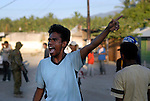 After losing his house and belongings to a random act of arson at Comoro, a young man voices his discontent outside the location of Prime Minister Alkartiri's party meeting and press conference. Dili East Timor 04/06/06