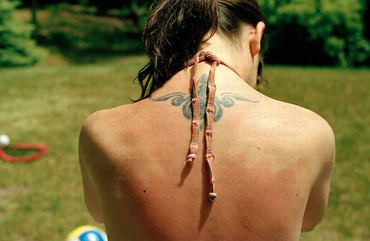 the back of young woman show the marks of a recent suntan