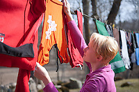 Close-Up of Woman Hanging Up Wet Laundry on Clothes Line