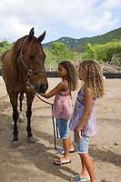 Girls with horse at Carolina Corral<br /> Coral Bay, St. John<br /> U.S.  Virgin Islands