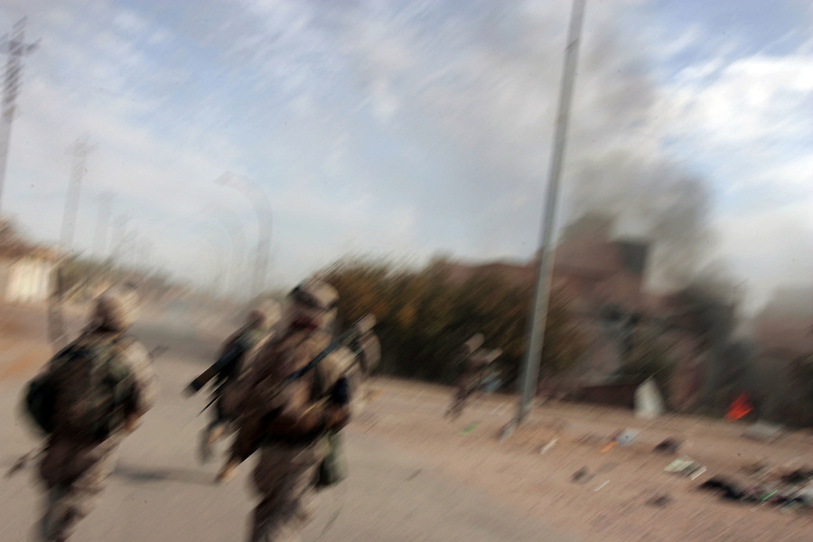 Marines from Golf Co. 2nd Battalion 1st Marines rush forward to take a group of houses from which it had been receiving sniper fire during the second day of Operation Steel Curtain, an operation to clear Husaybah (a city on the Iraq-Syrian border) of insurgents on Sun. Nov. 6, 2005. The operation, which has been labeled by the US military as one of the largest since the assault on Fallujah in Nov. 2004, involves more than 2,500 US personnel and 1,000 Iraqis.