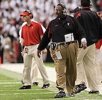 Texas Tech head coach Ruffin McNeill, right, watches play during the second half of the Valero Alamo Bowl, Saturday, Jan. 2, 2010, at the Alamodome in San Antonio. Texas Tech won 41-31. (Darren Abate/pressphotointl.com)