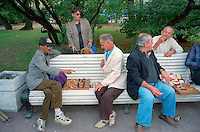 Saint Petersburg, Russia, August 2002..Unemployed and homeless men play chess in a city centre park. Fyodor Dostoyevsky,  chronicler of Russia's under class, would still recognise much in his native city. The streets he knew still teem with thieves, drunks, homeless &amp; those on the fringes of society..