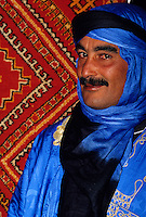 Tineghir, Morocco - Ismail bin Sharki, a Berber Rug Dealer.