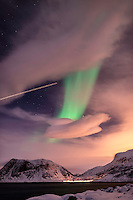 Northern lights through clouds and aircraft trail. (Photo by Travel Photographer Matt Considine)