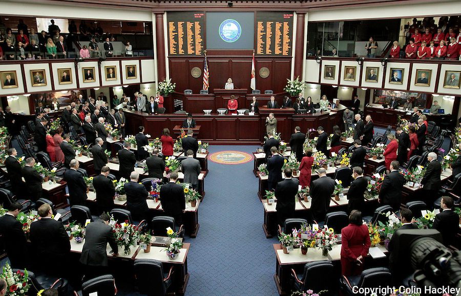 TALLAHASSEE, FL. 3/3/09-FLORIDA HOUSE2009 CH02-Members and visitors bow their heads in the House of Representatives chamber as a prayer is said during opening day ceremonies of the 2009 Legislative session, March 3, 2009 at the Capitol in Tallahassee, Fla...COLIN HACKLEY PHOTO