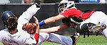 """Salina's Dalton Dooley (5) has the tag put on him by Pittsburgh's catcher Bryan Wade (3) at home plate on Wednesday, July 31, 2013, during the American Legion """"AAA"""" State Baseball tournament at Larks Park in Hays, Kansas. Salina played Pittsburgh in the first round. Out at Home"""