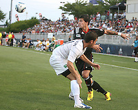 Santino Quaranta #25 of D.C. United tries to get past Jason Hotchkin #11 of the Harrisburg City Islanders during a US Open Cup match at the Maryland Soccerplex on July 21 2010, in Boyds, Maryland. United won 2-0.