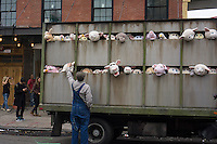 "Banksy enthusiasts flock to the trendy Meatpacking District in New York on Friday, October 11, 2013 to see the eleventh installment of Banksy's art, ""The Sirens of the Lambs"". This particular sculptural piece consists of a slaughterhouse truck filled with bleating plush animals, controlled by puppeteers, which were driven around by a driver,center, who remained in character. The elusive street artist is creating works around the city each day, during the month of October accompanied by a satirical recorded message parodying a museum tour which you can get by calling the number 1-800-656-4271 followed by  # and the number of artwork.  (© Frances M. Roberts)"