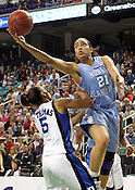 Jessica Breland (51) shoots over Duke's Jasmine Thomas (5). This was the Championship game of the 2011 ACC Tournament in Greensboro on March 6, 2011. Duke beat UNC 81-66. (Photo by Al Drago)