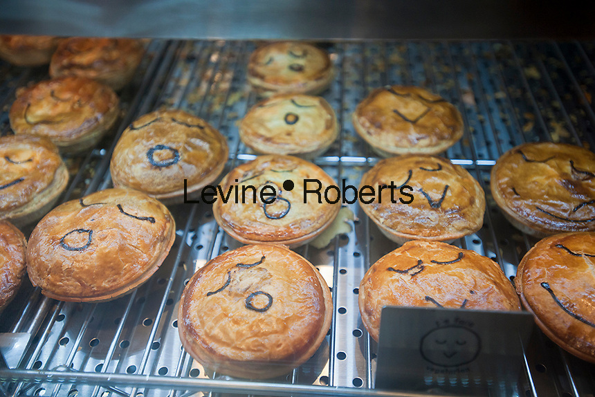 Sweet and savory pie lovers travel to West Midtown in New York to celebrate Australia Day, Thursday, January 26, 2012,  at the newly opened Australian bakery chain, Pie Face. The Aussie store offers an assortment of Australian delicacies akin to New York street food, they come in a handheld portable pie pack and the savories are filled with steak, mushroom, chicken and more.. (© Richard B. Levine)