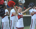 Cheerleaders perform at an Ole Miss pep rally in the Grove in Oxford, Miss. on Thursday, September 1, 2011.