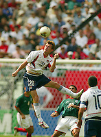 Brian McBride leaps for a header. The USA defeated Mexico 2-0 in the Round of 16 of the FIFA World Cup 2002 in South Korea on June 17, 2002.
