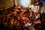 A pile of freshly butchered cow sculls on the floor at Basurto market near Cartagena, Colombia...Photo by Robert Caplin.