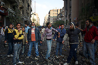 A group of young egyptian protestors make a human shield to prevent the advance of the security forces during violent clashes in central Cairo.