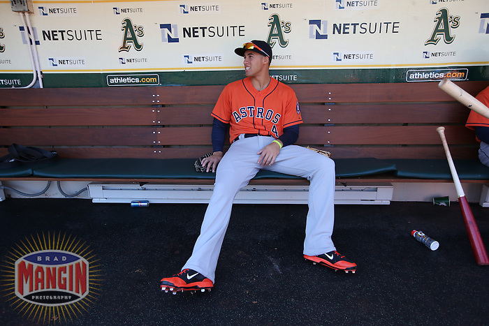 OAKLAND, CA - APRIL 19:  George Springer #4 of the Houston Astros sits in the dugout before the game against the Oakland Athletics at O.co Coliseum on Saturday, April 19, 2014 in Oakland, California. Photo by Brad Mangin