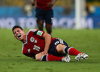 James Rodriguez of Colombia screams as he goes down with an injury