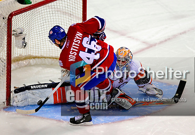 24 November 2008:  New York Islanders' goaltender Joey MacDonald makes a save against Montreal Canadiens' left wing forward Andrei Kostitsyn from Belarusse in an overtime shootout at the Bell Centre in Montreal, Quebec, Canada. The Canadiens, celebrating their 100th season, lost the shootout and the game 4-3. ****Editorial Use Only****..Mandatory Photo Credit: Ed Wolfstein Photo *** Editorial Sales through Icon Sports Media *** www.iconsportsmedia.com