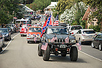 """Toyota pickup with U.S flags and the Confederate States of America """"Stars and Bars"""". Downtown main street during the Independence Day celebration Main Street, Mokelumne Hill, California"""