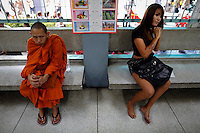 A transgender and a Buddhist monk wait aside from other youngsters  to speak to officers during the army draft held at a school in Klong Toey, the dockside slum area in Bangkok April 7, 2013. Men over 21 must serve in the army, which has always been at the forefront of Thai politics but has come in for some rare criticism since 91 people died in anti-government protests in 2010. Those who volunteer serve six months, but others choose the annual lottery, which goes on for 10 days in recruitment centres around Thailand. Nobody wants a red card, which means serving for two years, with the chance of a posting in the dangerous south. Only those not considered physically capable of service, the mentally ill and those who have significantly altered their physical appearance - such as transgenders, who are more visible in Thai society than in many other nations - are exempt.   REUTERS/Damir Sagolj (THAILAND)