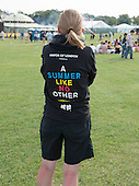 """A summer like no other"" hoodie worn by one of the helpers at ""Showtime"", part of the London 2012 Festival of Arts to celebrate the London Olympics.  A family fun spectacle including dance, painting, music, acrobatics and some large mobile dynosaurs walking amongst the crowd.  On Blackheath Common, Saturday August 4th and funded by the Mayor of London and Arts Council England."
