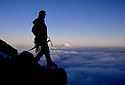 CC91138-60...WASHINGTON - Climber on Mount Rainier with Mount Adams in the distance. Mount Rainier National Park. (MR#K1)