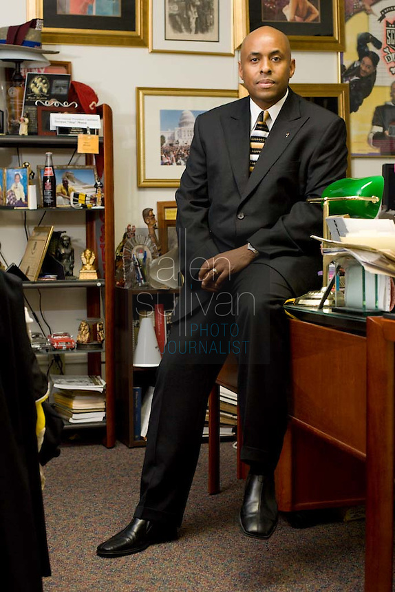 """Herman """"Skip"""" Mason poses in his office at Morehouse College. Decades of research helped Mason organize a reunion recently of people descended from Mason's slave ancestors and from the owners of those slaves."""