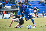 St Johnstone v St Mirren....22.01.11  .Collin Samuel tackled by John Potter.Picture by Graeme Hart..Copyright Perthshire Picture Agency.Tel: 01738 623350  Mobile: 07990 594431