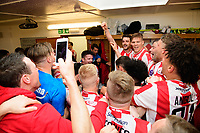 The Lincoln City players celebrate in the changing room after the game<br /> <br /> Photographer Chris Vaughan/CameraSport<br /> <br /> Vanarama National League - Lincoln City v Macclesfield Town - Saturday 22nd April 2017 - Sincil Bank - Lincoln<br /> <br /> World Copyright &copy; 2017 CameraSport. All rights reserved. 43 Linden Ave. Countesthorpe. Leicester. England. LE8 5PG - Tel: +44 (0) 116 277 4147 - admin@camerasport.com - www.camerasport.com