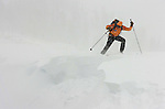 Sierra Avalanche Center forecaster Andy Anderson kicks off a cornice and sets off a small avalanche on a test hill near the Sierra Crest during Thursday's storm. Winds gusted up to 112 mph along the crest as Anderson worked gathering information on snow stability for the centers daily avalanche forecasts.