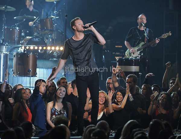 LAS VEGAS, NV - MAY 18: 5 Dan Reynolds of Imagine Dragons performs on the 2014 Billboard Music Awards at the MGM Grand Garden Arena on Sunday, May 18, 2014 in Las Vegas, Nevada. PGMicelotta/MediaPunch